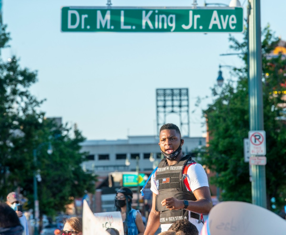 <strong>DeVante Hill speaks to a group of non-violent protesters as they kneel at Dr. M.L. King Jr. Ave and Third Street after gathering at the I Am a Man Plaza, Saturday, June 6, 2020.</strong> (Greg Campbell/Special for The Daily Memphian)