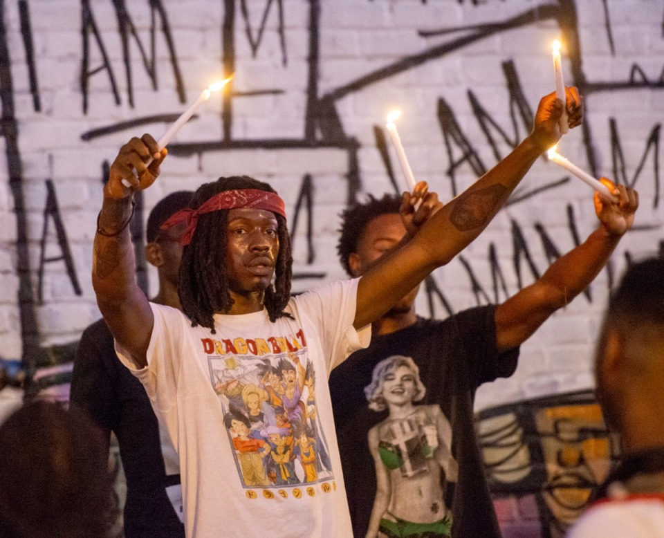<strong>Protesters pause at the I Am a Man mural on Main Street as they make their way back to I Am a Man Plaza by the Clayborne Temple Saturday June 6, 2020.</strong> (Greg Campbell/Special for The Daily Memphian)