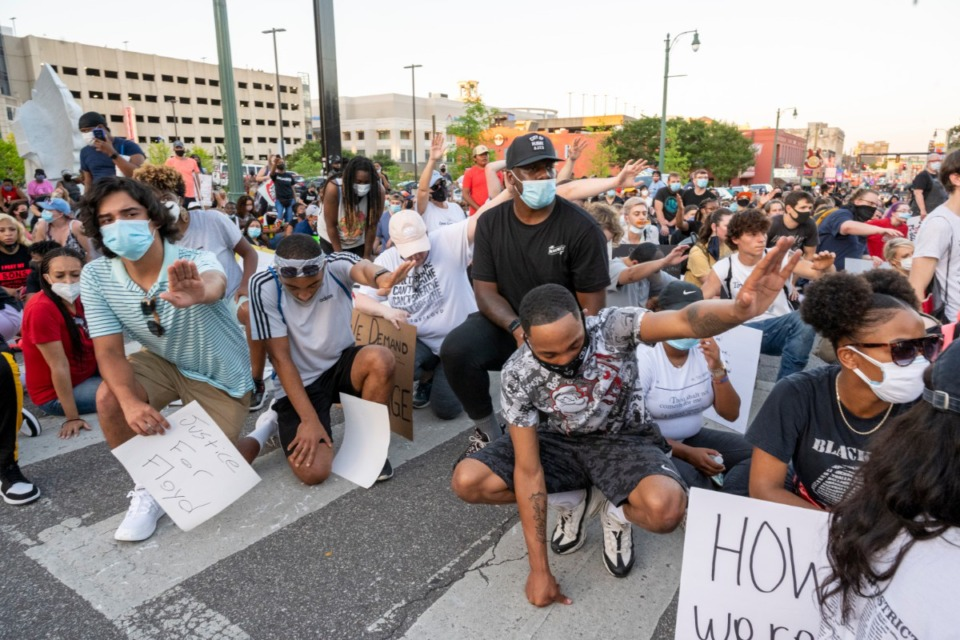 <strong>A group of protesters pauses and prays for a man having a seizure during a protest on Beale Street Saturday night, June 6, 2020. Paramedics were called to attend to the man.</strong> (Greg Campbell/Special for The Daily Memphian)