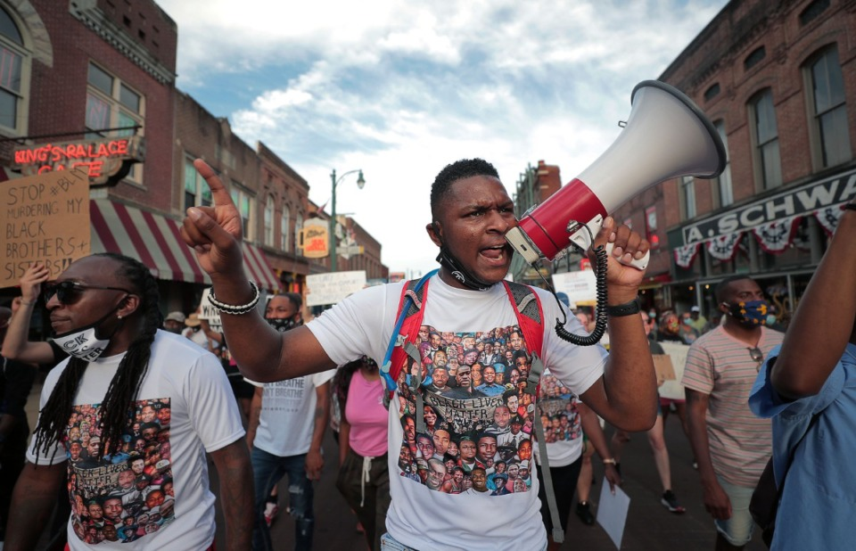 <strong>DeVante Hill marches down Beale Street June 7, 2020 during the twelfth day of protesting over the death of George Floyd.</strong> (Patrick Lantrip/Daily Memphian)