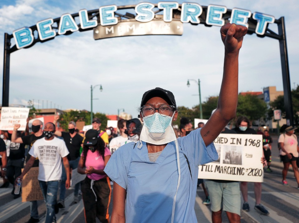 <strong>Protesters march down Beale Street June 7, 2020 during the twelfth night of protests over the death of George Floyd.</strong> (Patrick Lantrip/Daily Memphian)