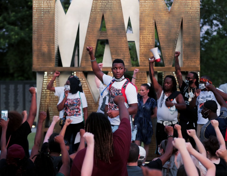 <strong>DeVante Hill asks the crowd gathered at I Am A Man Plaza to raise their fists in solidarity June 7, 2020 during the twelfth night of protests over the death of George Floyd.</strong> (Patrick Lantrip/Daily Memphian)