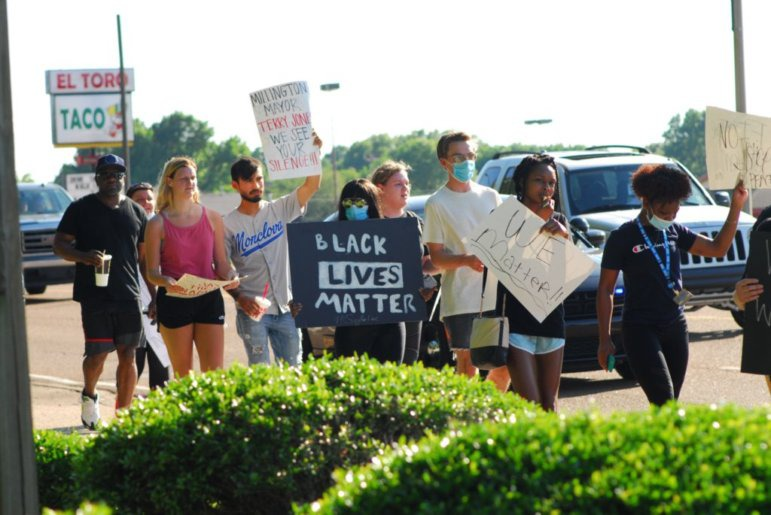 <strong>A group of about 50 protesters gathered near Millington Municipal Schools Central Office June 6, 2020 to protest the death of George Floyd before marching down Navy Road.</strong> (Brent Ford/Special to the Daily Memphian)