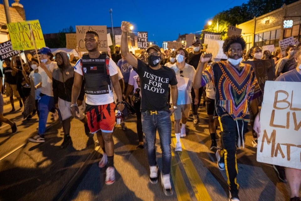 <strong>Protesters march down Main Street Saturday night, June 6, 2020. The evening curfew that has been in force for a week was lifted Monday, June 8.</strong> (Greg Campbell/Special for The Daily Memphian)