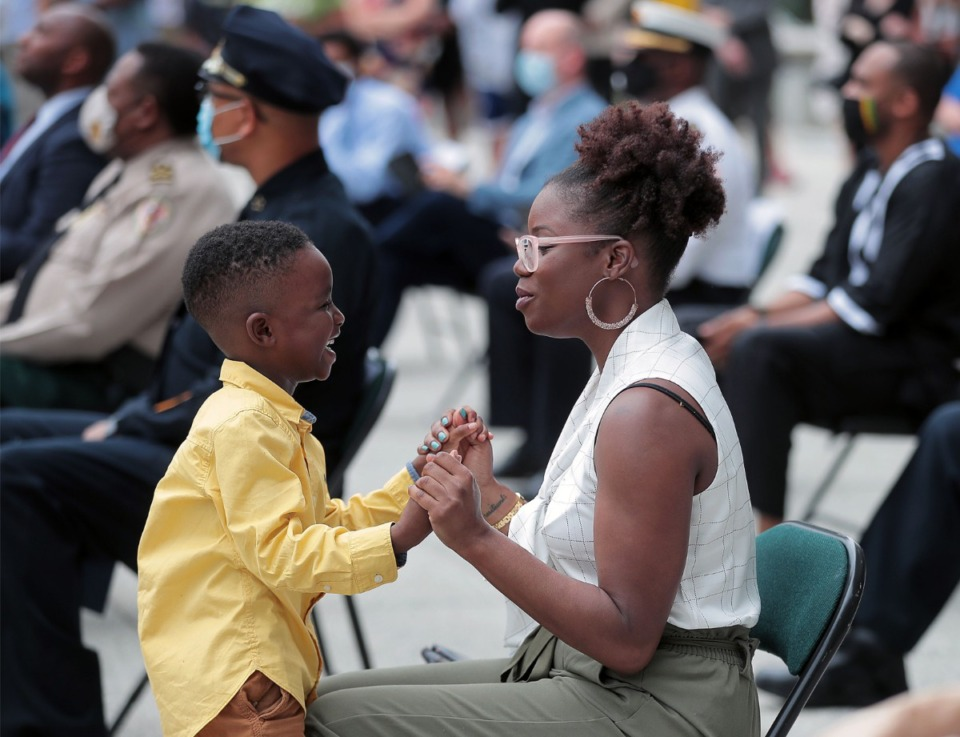 "<strong>Shelby County chief of staff Danielle Inez sings ""Lean on Me"" with her five-year-old son Joseph during a memorial service held for George Floyd at Civic Center Plaza in Downtown Memphis June 8, 2020.</strong> (Patrick Lantrip/Daily Memphian)"