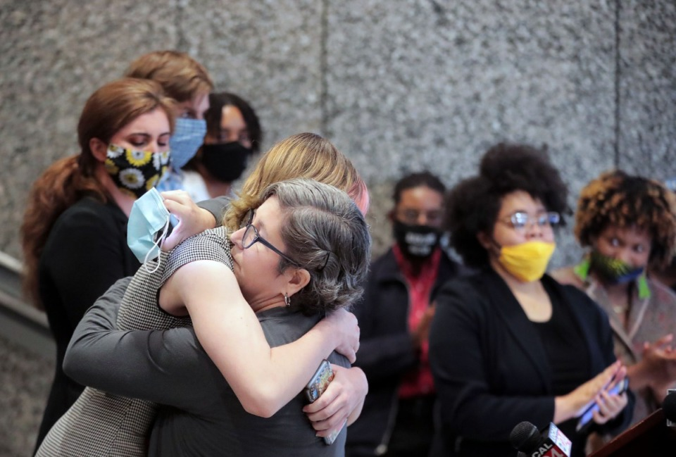<strong>Lydia Barnat (right) hugs her mother Shiloh Barnat Goodman during a June 8, 2020, press conference held by Shelby County Commissioner Tami Sawyer to address an incident where motorists ran into a crowd of protesters in Cooper-Young on June 6, 2020.</strong> (Patrick Lantrip/Daily Memphian)