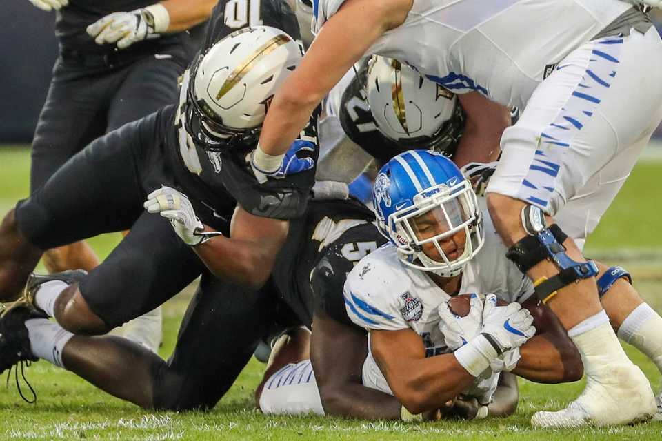 <strong>University of Memphis wide receiver Tony Pollard (1) is tackled during the AAC Championship football game between the Tigers and the UCF Knights on Dec. 1, 2018, at Spectrum Stadium in Orlando, Fla.</strong> (AP Photo/Joe Petro)