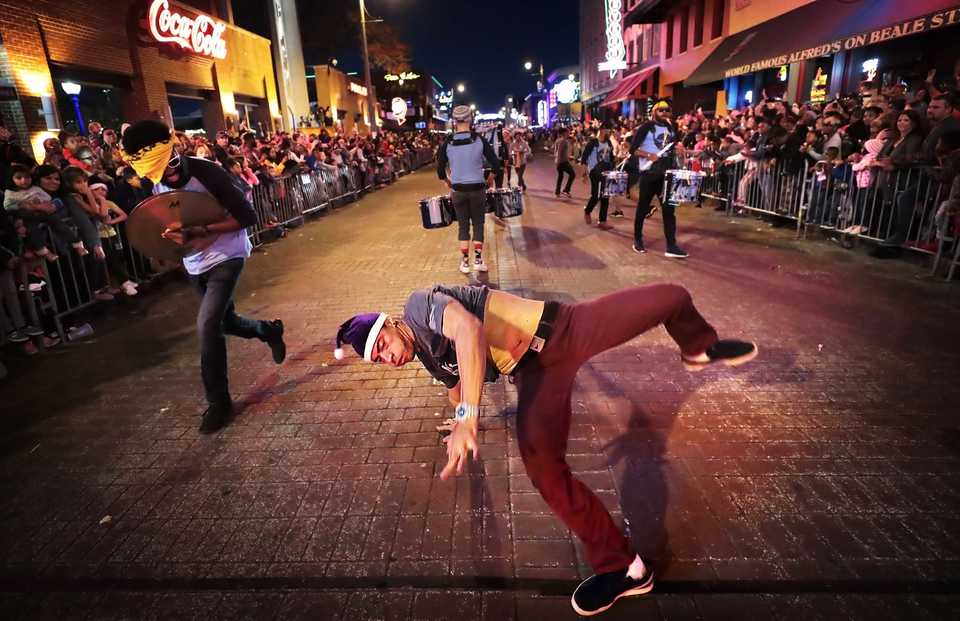 <strong>Bboy Kay performs with the Grizzline during the 2018 Memphis Holiday Parade on Beale Street on  Dec. 1. Though the parade was delayed due to the late-running St. Jude Memphis Marathon that took place Saturday Downtown, it didn't deter thousands of Memphians from lining Beale to watch dancers, bands, floats, motorcycles and Santa usher in the holiday season.</strong> (Jim Weber/Daily Memphian)