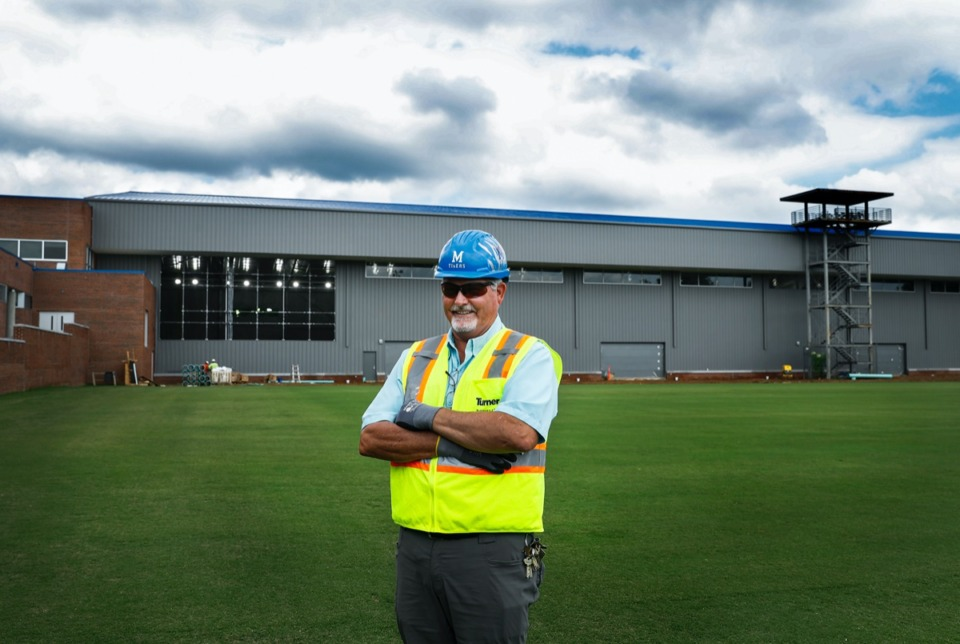 <strong>University of Memphis Facility Management Specialist John Flowers stands in front of the new indoor football practice facility on Tuesday, June 9, 2020. Flowers, who came to the University in 1985 as the Director of Football Operations under head coach Rey Dempsey, now oversees renovation and construction projects on campus.</strong> (Mark Weber/Daily Memphian)