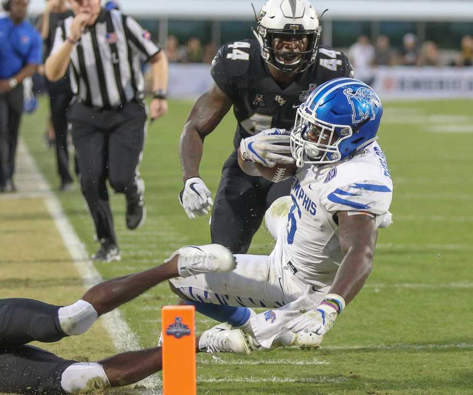 <strong>University of Memphis tight end Sean Dykes (6) is tackled near the goal line during the AAC football championship game between the U of M Tigers and the UCF Knights on Saturday, Dec. 1, 2018, in Orlando, Fla.</strong> (AP Photos/Kyle Okita)