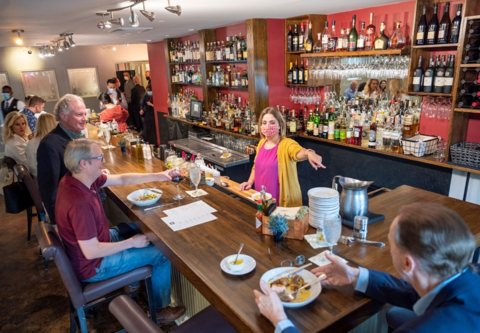 <strong>Erling's bartender Maggie McLendon directs a patron in the new bar area on Friday, June 5, 2020.</strong> (Greg Campbell/Special for The Daily Memphian)