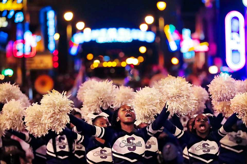 <strong>Soulsville Charter School cheerleaders perform during the 2018 Memphis Holiday Parade on Beale Street on Dec. 1. Though the parade was delayed due to the late-running St. Jude Memphis Marathon that took place Saturday Downtown, it didn't deter thousands of Memphians from lining Beale to watch dancers, bands, floats, motorcycles and Santa usher in the holiday season.</strong>&nbsp;(Jim Weber/Daily Memphian)