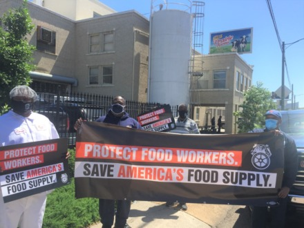 <strong>Teamsters union local No. 667 members and officials protest outside Prairie Farms dairy in Midtown as part of a national Day of Action asking Congress to fund more protections for the food supply chain and its workers.</strong> (Wayne Risher/Daily Memphian)
