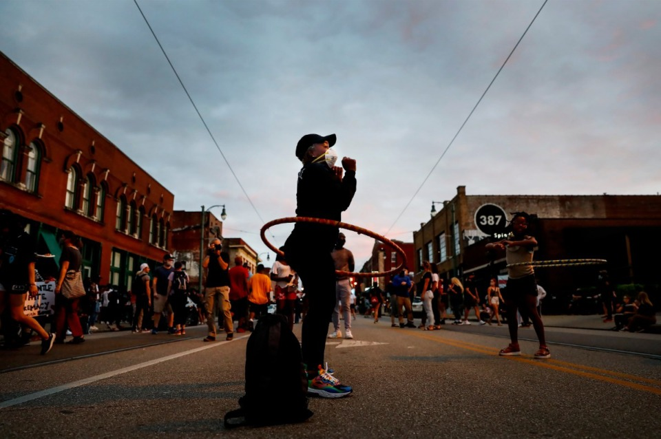 <strong>Bridgete Sismey hula hoops on Wednesday, June 10, 2020, during a Defund the Police Block Party on South Main.</strong> (Mark Weber/Daily Memphian)