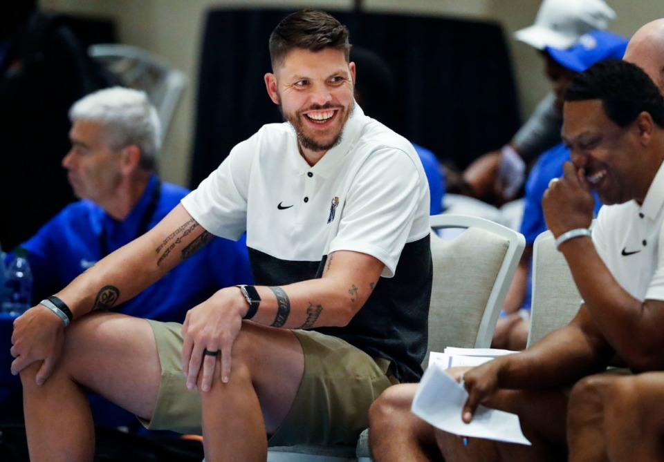 <strong>Former Memphis Tigers assistant coach Mike Miller (left) jokes on the bench during an exhibition game in the Bahamas last August.</strong> (Mark Weber/Daily Memphian file)