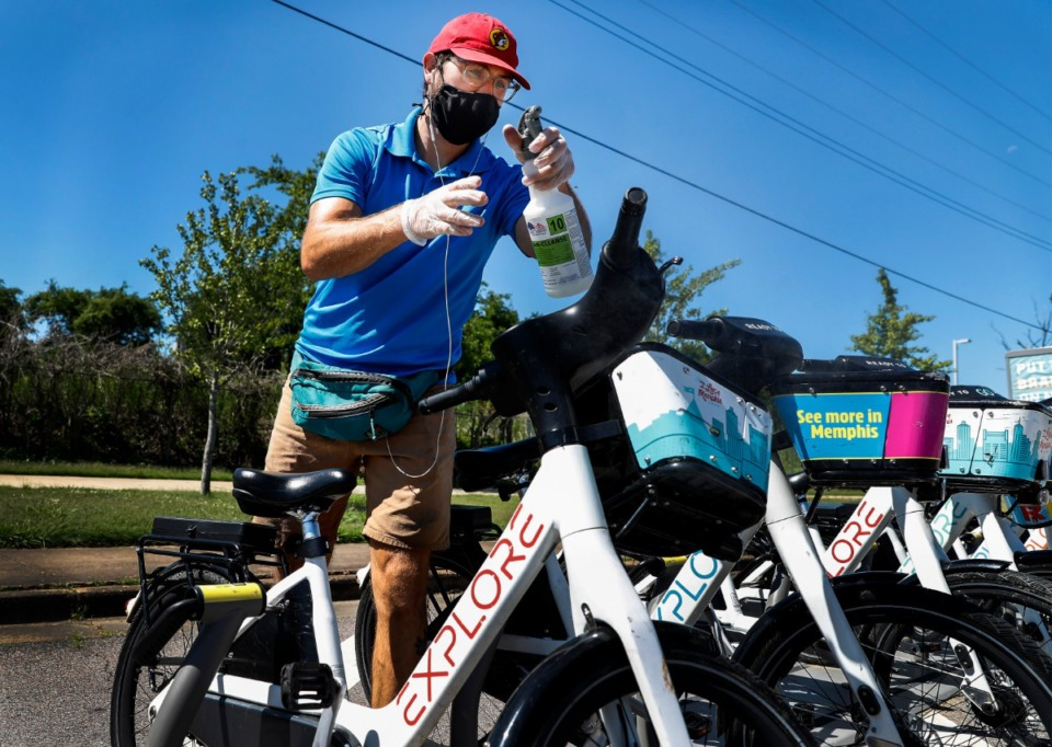 <strong>Explore Bike Share&rsquo;s Bike Fleet Manager Shea Kizzell services bikes on Friday, June 11, 2020, at the Big River Crossing. The bicycle ride-share nonprofit is celebrating its two-year anniversary.</strong> (Mark Weber/Daily Memphian)