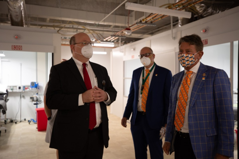 <strong>Dr. Richard Walker (left), discusses the pandemic with Dr. Scott Strome, dean of the UTHSC College of Medicine (middle) and UT President Randy Boyd during Gov. Bill Lee&rsquo;s visit in May.</strong> (Submitted)