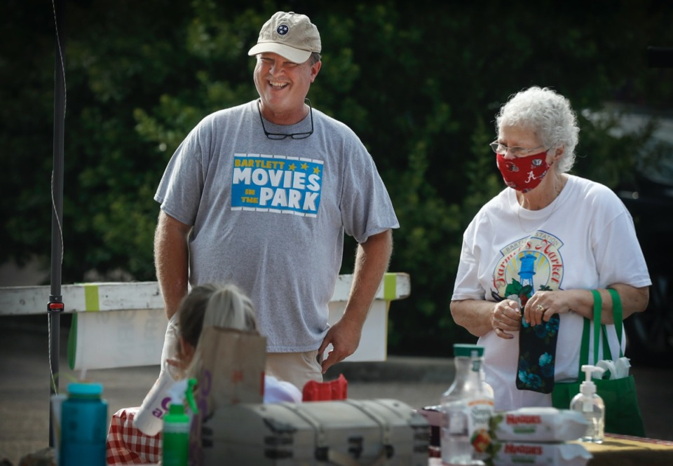 <strong>Glen Mullins (left), the new chairman of the Bartlett Station Commission, chats with customers at The Bartlett Station Farmer's Market, which kicked off its new season on Saturday, June 13, 2020.</strong> (Mark Weber/Daily Memphian)