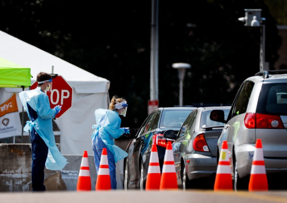 <strong>Staff and students from the University of Tennessee Health Science Center work with the Shelby County Health Department on Wednesday, April 1, 2020, to continue drive-thru testing for COVID-19 at the Memphis Fairgrounds.</strong> (Mark Weber/ The Daily Memphian file)