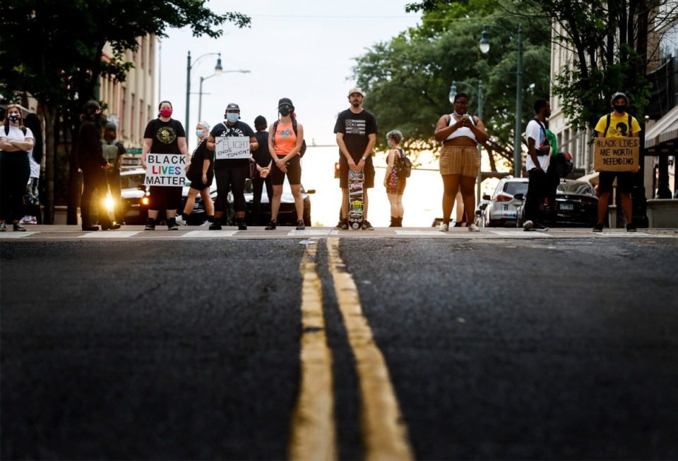 <strong>Protesters block the intersection of N. Main St. and Monroe Ave. at the entrance of Flight Restaurant and Wine Bar on Saturday, June 13, 2020. Recent social media posts accused the restaurant of racism and sexism.</strong> (Mark Weber/Daily Memphian)