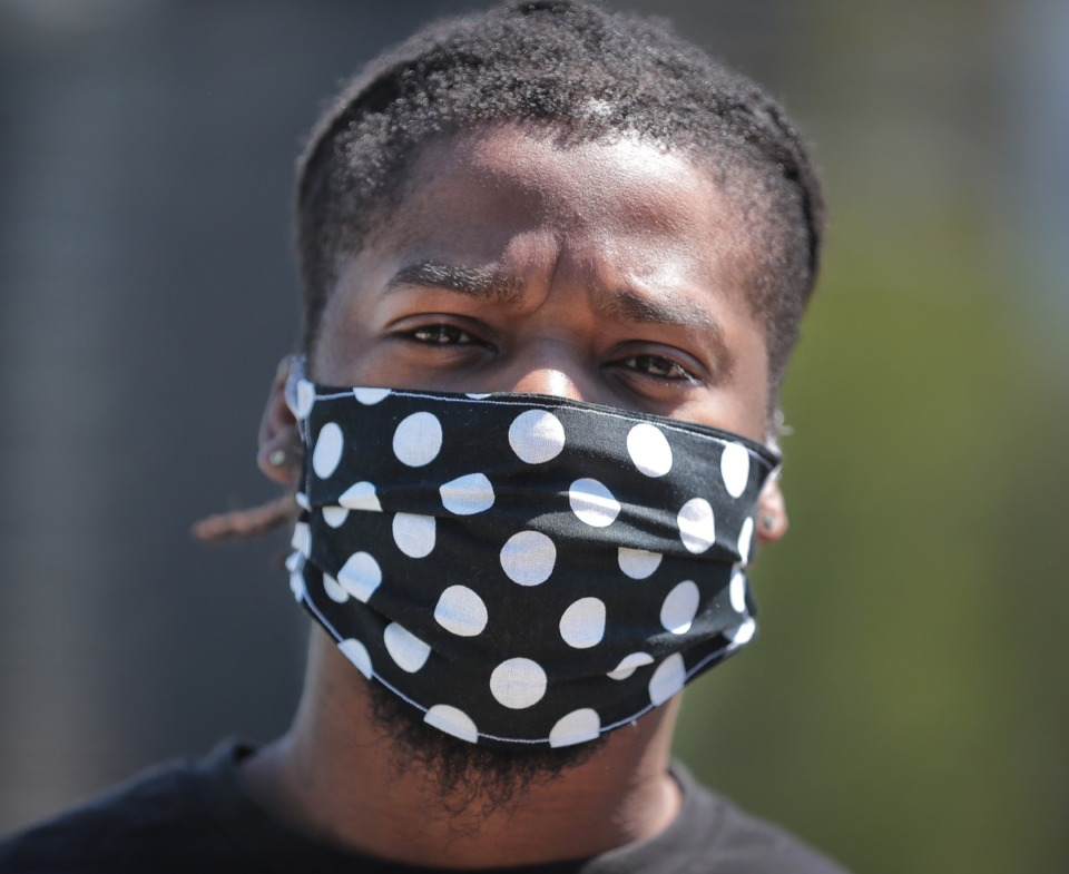 <strong>Tayy Thepro goes with a polka dot mask during a walks along the bluff neat Tom Lee Park in Downtown on May 1, 2020. The new mask&nbsp;measure took effect with Tuesday&rsquo;s passage by the City Council, rbut may face challenges.</strong> (Jim Weber/Daily Memphian)