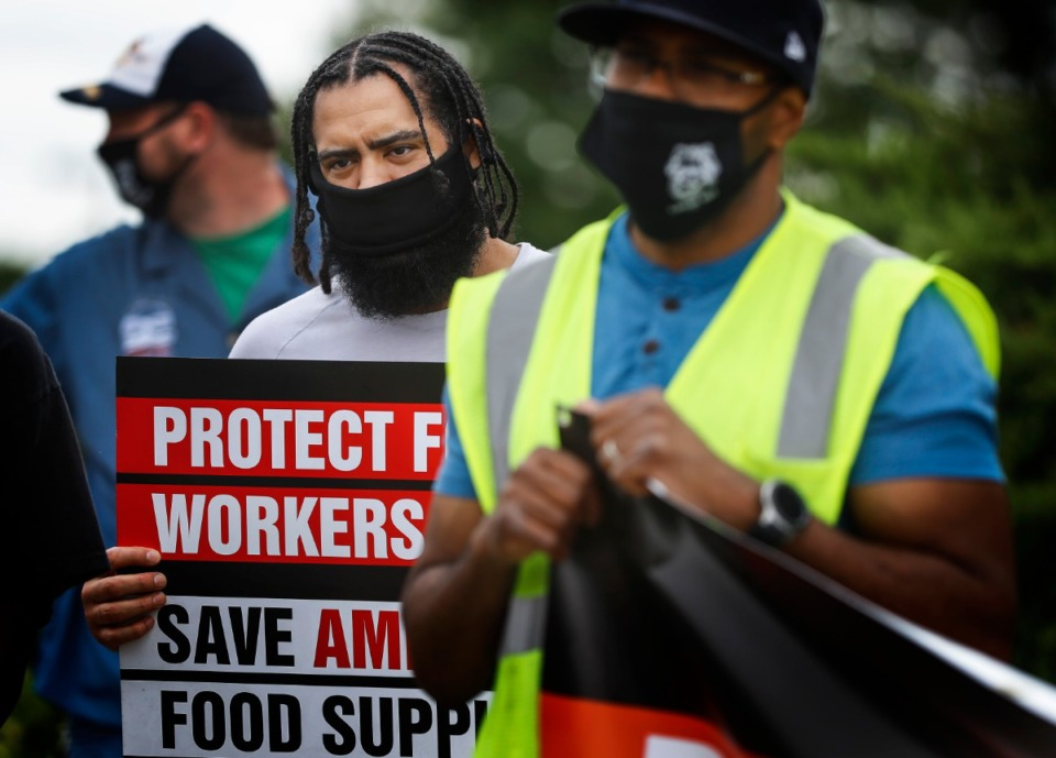 Kroger employee Chris Franceschi (middle) attends a protest on Wednesday, June 10, 2020 outside the Kroger Delta Division Distribution Center on Bledsoe Road. Teamster union members held a press conference, calling for more COVID-19 protections of workers and products in the food service supply chain. (Mark Weber/Daily Memphian)