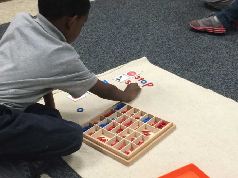 <strong>&nbsp;A student at Libertas School of Memphis spells out words next to pictures as part of his independent learning time at the Montessori school in the Frayser community. The school is one of 10 in the state awarded a new school improvement grant.</strong> (Laura Faith Kebede/Chalkbeat)