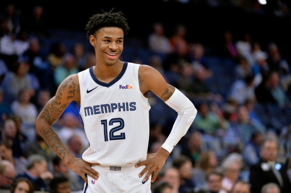 <strong>Memphis Grizzlies guard Ja Morant (12) smiles during a game against the Golden State Warriors last November.</strong> (AP file Photo/Brandon Dill)