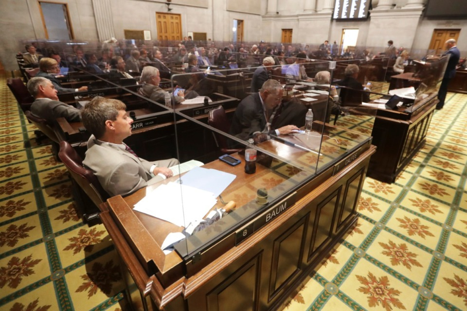<strong>Rep. Charlie Baum, R-Murfreesboro, front left, and other House members sit behind glass partitions due to the coronavirus pandemic during a House session Tuesday, June 9, 2020, in Nashville.</strong> (Mark Humphrey/AP)