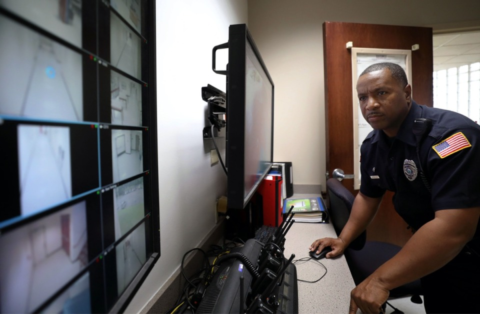 <strong><span>The City of Memphis hopes to amend a 40-year-old consent decree so police officers could use technology more freely in their work.</span> Pictured above, an officer monitors the video board at the Southwest Tennessee Community College&rsquo;s police headquarters on Union.</strong> (Patrick Lantrip/Daily Memphian file)