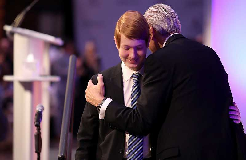 <strong>ALSAC CEO Richard Shadyac embraces high school cancer survivor Chandler Howard after the latter's speech during a press conference announcing the largest single donation in the history of St. Jude Children's Hospital.</strong> (Patrick Lantrip/Daily Memphian)