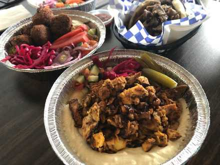<strong>A hummus bowl with chicken shwarma (front), falafel (left) and a gyro sandwich are among many bargains at Happy Greek Cafe on Highland.</strong> (Jennifer Biggs: Daily Memphian)
