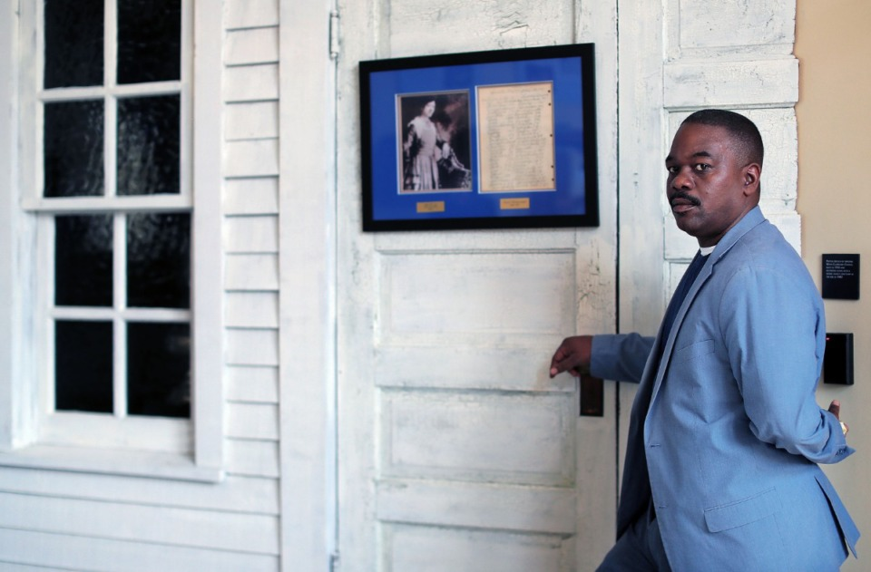<strong>Brown Missionary Baptist Church historian Errol Harmon stands near a replica of the white clapboard church the Southaven church grew from.&nbsp;</strong><span><strong>His ancestors, former slaves, helped to found the congregation in 1882.</strong>&nbsp;</span>(Patrick Lantrip/Daily Memphian)