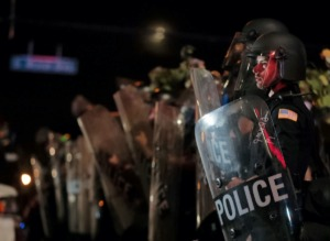 <strong>Since George Floyd's death, a proposal for hiring police officers and firefighters who live outside the city and county is getting another look. Pictured here, a Memphis Police officer looks out into the crowd during a May 28, 2020 protest over the death of George Floyd.</strong> (Patrick Lantrip/Daily Memphian file)