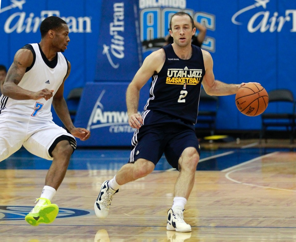 <strong>Blake Ahearn (2), the new assistant coach for the Grizzlies who played for the&nbsp;Utah Jazz in 2012, is shown in this file photo moving the ball downcourt past Oklahoma City Thunder's Marquez Haynes (7) during an NBA summer league basketball game, Friday, July 13, 2012, in Orlando, Fla.</strong> (John Raoux/AP file)