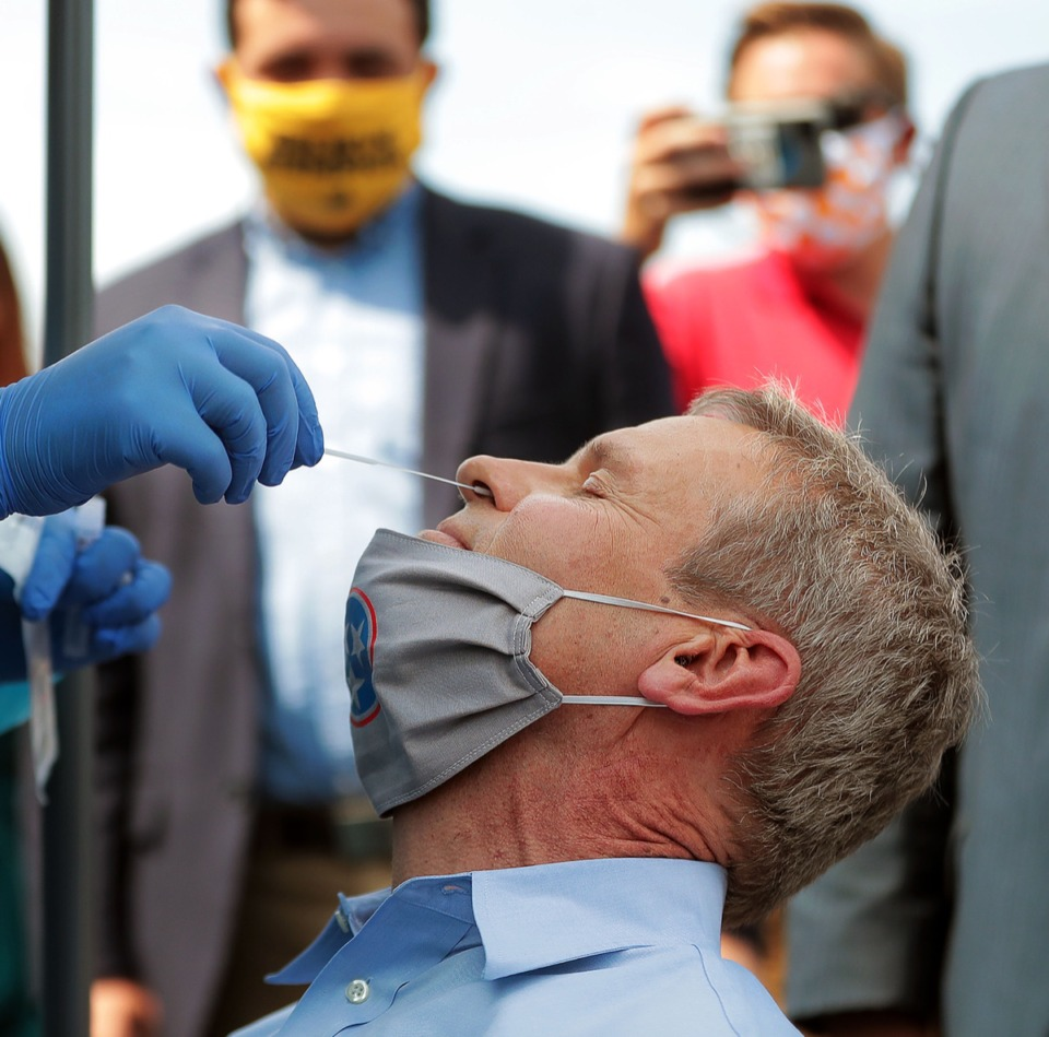 <strong>Tennessee Governor Bill Lee gets a COVID-19 test in front of a group of onlookers at Mississippi Boulevard Christian Church in Memphis June 19, 2020.</strong> (Patrick Lantrip/Daily Memphian)