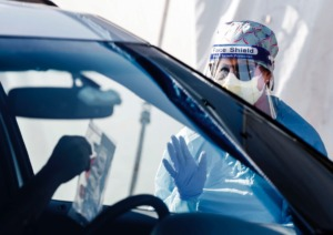 <strong>Registered nurse Holly Cote administers COVID-19 tesing swabs during a drive-thru testing site Thursday, June 18, 2020 at Baptist Memorial Hospital-Memphis.</strong> (Mark Weber/Daily Memphian)