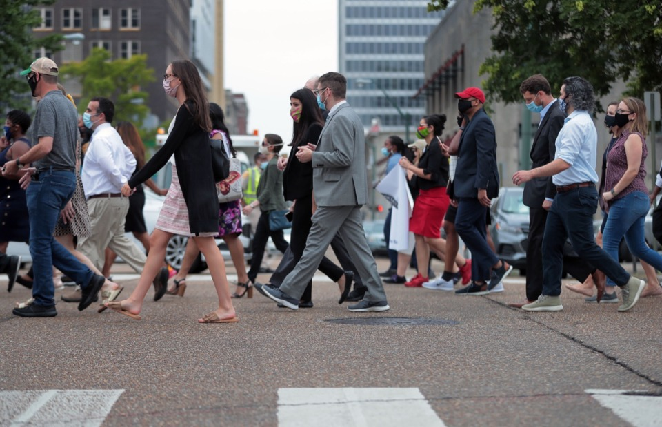 <strong>Legal professionals cross the intersection of B.B. King Boulevard and Adams Street during a protest about systemic racism in the legal system.</strong> (Patrick Lantrip/Daily Memphian)
