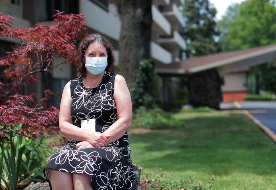<strong>Emilia Pinto sits in the garden of her East Memphis apartment building June 23, 2020. Pinto, who hails from Brazil, has discovered a gene that is linked to cancer in a large segment of the Brazilian population through her research at St. Jude Children's Hospital.</strong> (Patrick Lantrip/Daily Memphian)