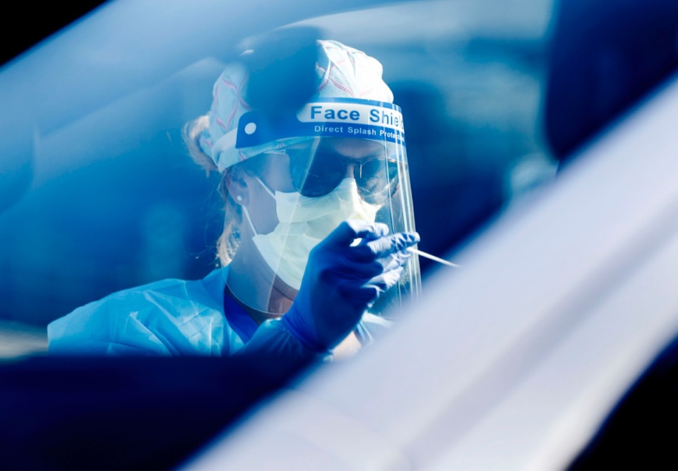 <strong>Registered nurse Holly Cote administers COVID-19 swaps during a drive-thru testing site Thursday, June 18, 2020 at Baptist Memorial Hospital-Memphis.</strong> (Mark Weber/Daily Memphian)