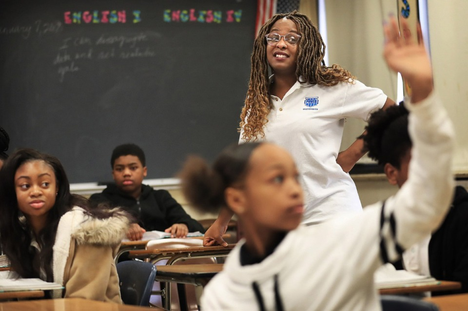 <strong>Peer Power's Danielle Nelson (in a 2019 file photo) works with a ninths-grade English class at Whitehaven High School. Peer Power recruits, trains and employs University of Memphis students to work alongside teachers in classrooms as 'success coaches' for younger students.</strong> (Jim Weber/Daily Memphian file)