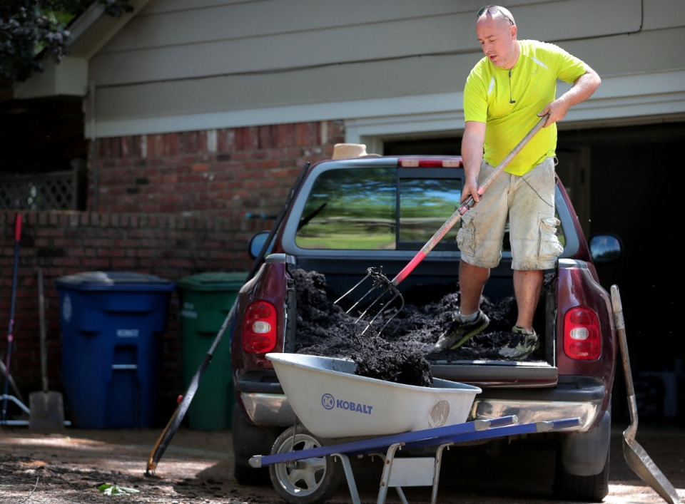 <strong>Scott Briggs (in an April, 11, 2020 photo) started a lawn care business called Laid Off Lawncare after losing his job as a bartender</strong>. (Jim Weber/Daily Memphian file)