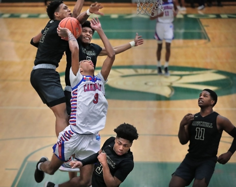 <strong>During the coronavirus pandemic, Wooddale's Jalen Brown (3) &ndash; pictured here being fouled on a shot attempt during a game on Feb. 15, 2020 &ndash; is working hard on his game. But, for the first time in a while, he's also getting to play basketball for fun with his buddies.</strong>&nbsp;(Jim Weber/Daily Memphian file)