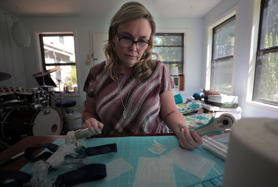 <strong>Kristen Archbold works on an invention known as the Port Patch that converts CPAP devices into PPE at her Germantown home office June 25, 2020.</strong> (Patrick Lantrip/Daily Memphian)