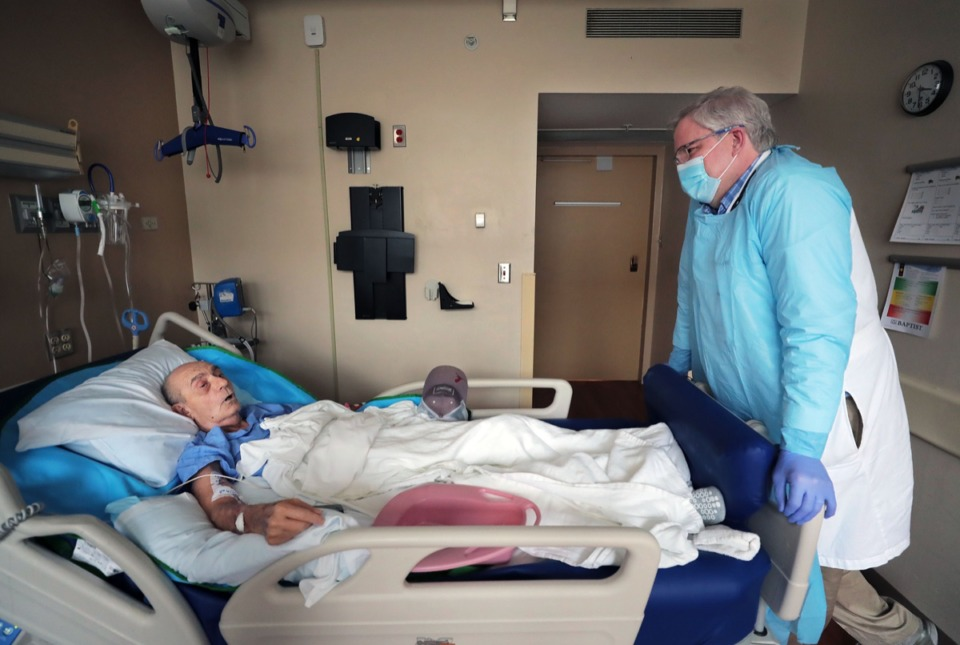 <strong>Thomas Bryant talks with Dr. Steve Threlkeld at Baptist Memorial Hospital-Memphis on June 26, 2020. Byrant, the world's second-longest living heart transplant survivor, has also survived COVID-19.</strong> (Patrick Lantrip/Daily Memphian)
