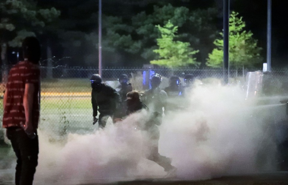 <strong>As the protesters who had been blocking Interstate 55 retuned to the city, they attempted to shut down the Hernando Desoto Bridge, which spans the Mississippi River into Arkansas, on May 31, 2020. They were met with a barrage of tear gas and pepper spray from Shelby County Sheriff's deputies.</strong> (Patrick Lantrip/Daily Memphian)