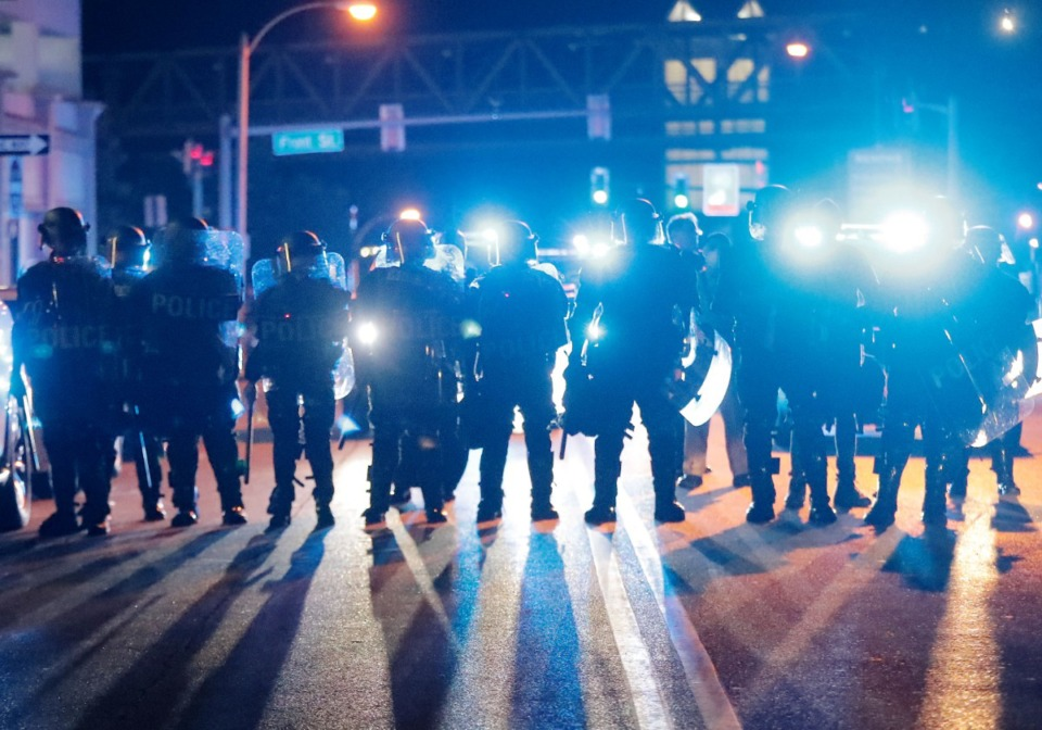 <strong>After the protesters' second attempt to take the Hernando Desoto Bridge, Memphis Police officers in riot gear follow the remaining protesters throughout Downtown Memphis, pushing them away from the bridge into the early hours of June 1, 2020.</strong> (Patrick Lantrip/Daily Memphian)