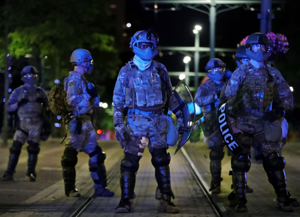 <strong>The night following the attempted shutdowns of the Hernando Desoto Bridge, a heavy National Guard presence was stationed in and around the Clifford Davis-Odell Horton Federal Building as protests continued in Downtown Memphis.</strong> (Patrick Lantrip/Daily Memphian)
