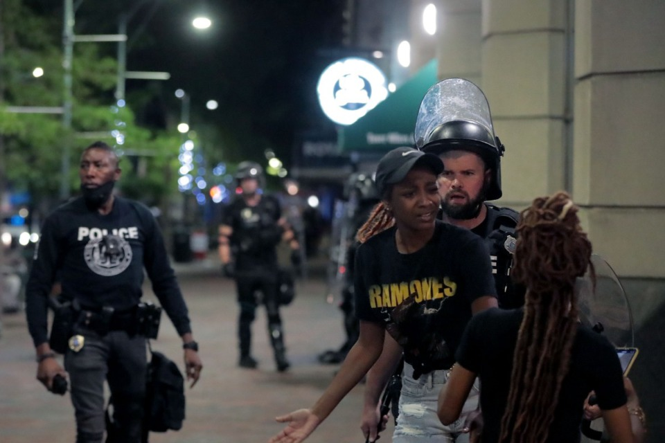 <strong>As the protesters' numbers began to dwindle, the Memphis Police began rounding up the remaining protesters who hung around Downtown in the early hours of June 1, 2020.</strong> (Patrick Lantrip/Daily Memphian)