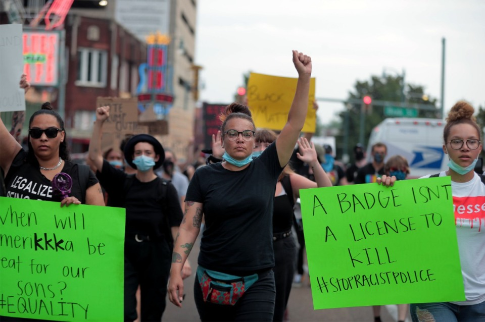 <strong>LJ Abraham (center), pictured here marching near Beale Street on June 3, 2020, was another protest leader who split from the Devante Hill-led marches. Abraham struck a middle-ground between Hill and Abston's marches and primarily focused on targeting and exposing racist practices in local business in Memphis.</strong> (Patrick Lantrip/Daily Memphian)